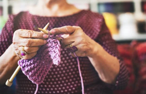 Lady knitting as a hobby