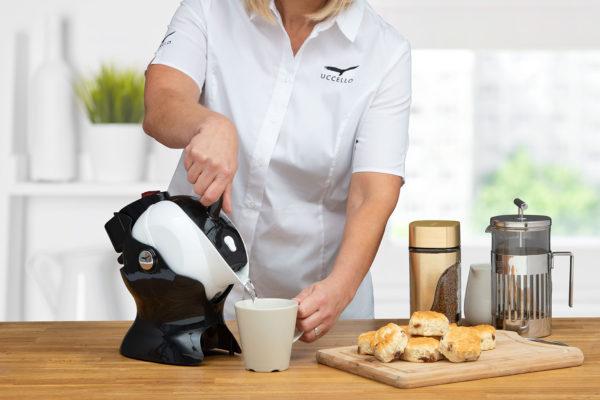 Lady using the tilt-to-pour action of the Uccello Kettle